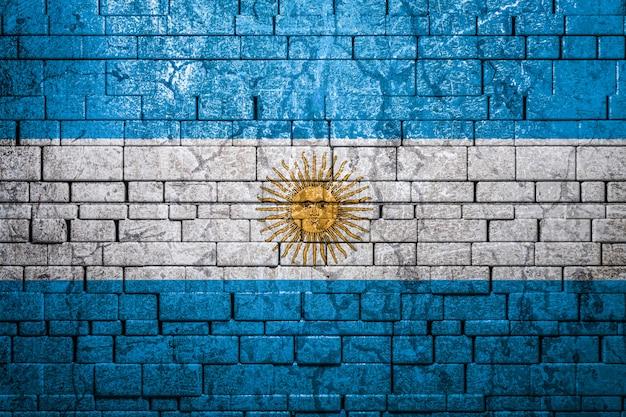 Bandera nacional de argentina en pared de ladrillo
