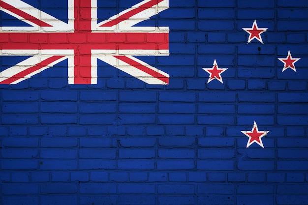 Bandera nacional de nueva zelanda que representa en una vieja pared de ladrillos
