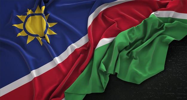 Bandera de namibia arrugado sobre fondo oscuro 3d render