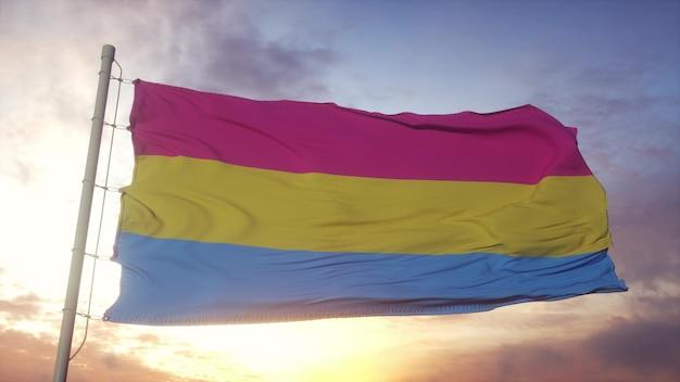 Bandera del orgullo de la pansexualidad ondeando en el fondo del viento, el cielo y el sol. representación 3d