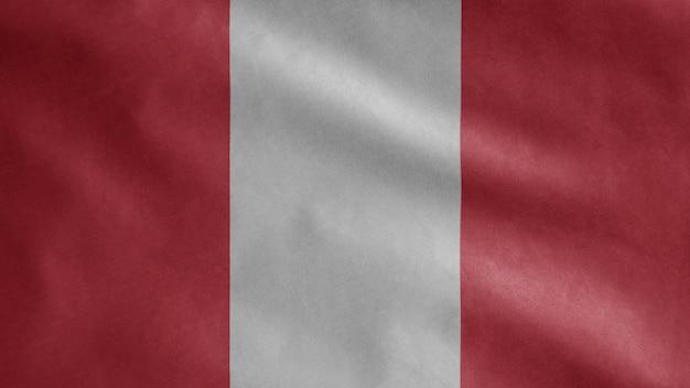 Bandera peruana ondeando en el viento. cerca de plantilla de perú soplado, seda suave y lisa. fondo de la bandera de la textura de la tela del paño.