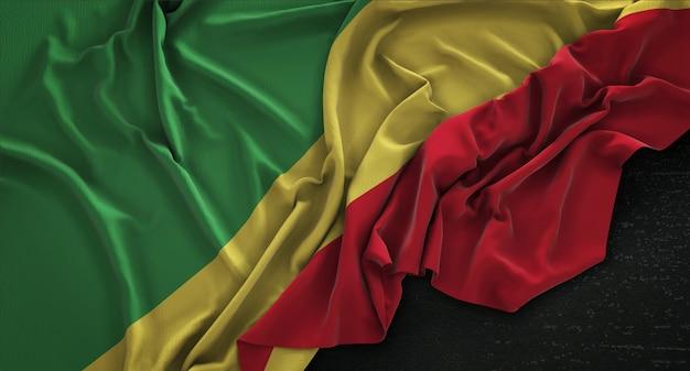 Bandera de la república del congo arrugada sobre fondo oscuro 3d render