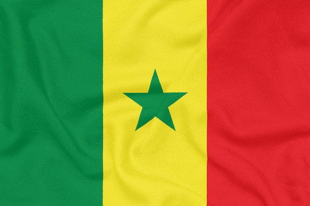 Bandera de senegal sobre tela con textura. símbolo patriótico
