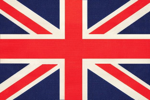 Bandera de tela nacional de gran bretaña, fondo textil. símbolo del reino unido.