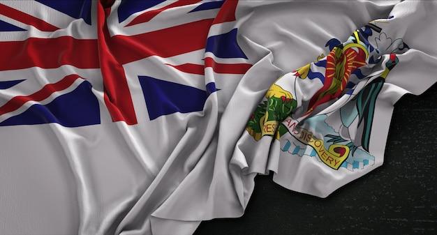 Bandera del territorio antártico británico arrugado sobre fondo oscuro 3d render