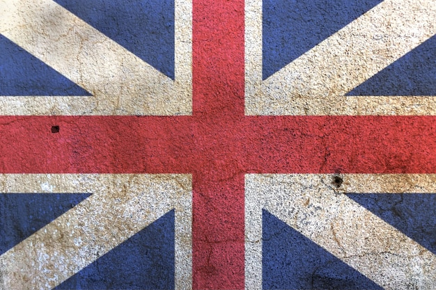 Bandera de union jack en la pared blanca