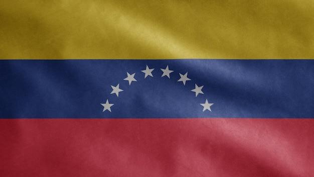 Bandera venezolana ondeando en el viento. plantilla de venezuela soplada, seda suave y lisa. fondo de la bandera de la textura de la tela del paño. úselo para el concepto de ocasiones de día nacional y país.
