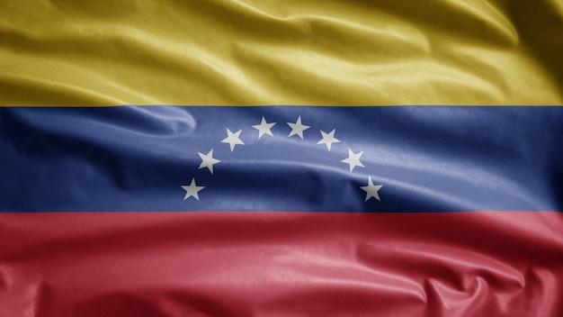 Bandera venezolana ondeando en el viento. plantilla de venezuela soplada, seda suave y lisa. fondo de la bandera de la textura de la tela del paño.