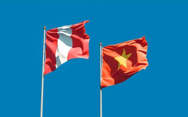 Banderas de perú y vietnam sobre fondo de cielo