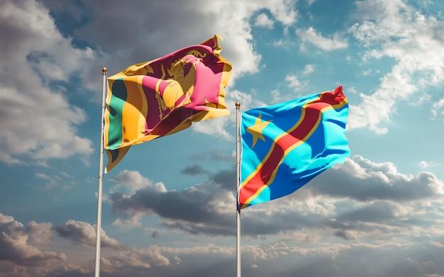 Banderas de sri lanka y la república democrática del congo sobre fondo de cielo