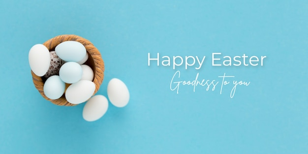Banner de pascua con huevos sobre un fondo azul.