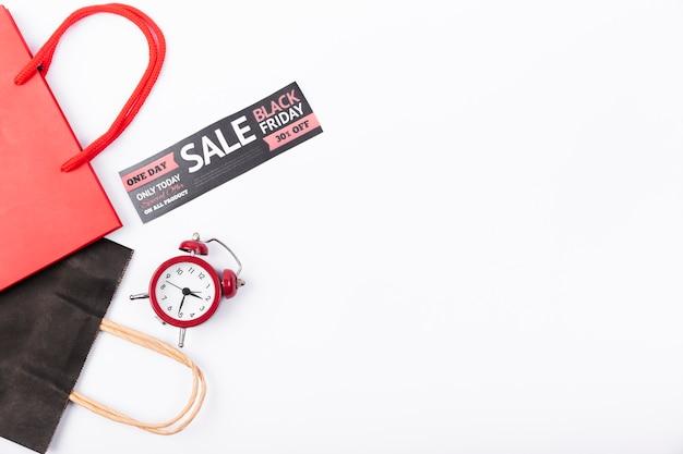 Banner de venta de viernes negro con reloj despertador