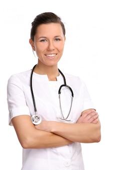 Una bella y joven doctora en blanco