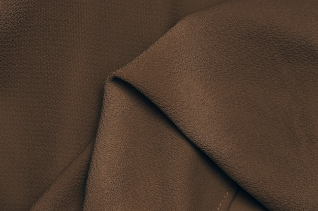 Belleza de primer plano de fondo de textura de seda de tela marrón oscuro