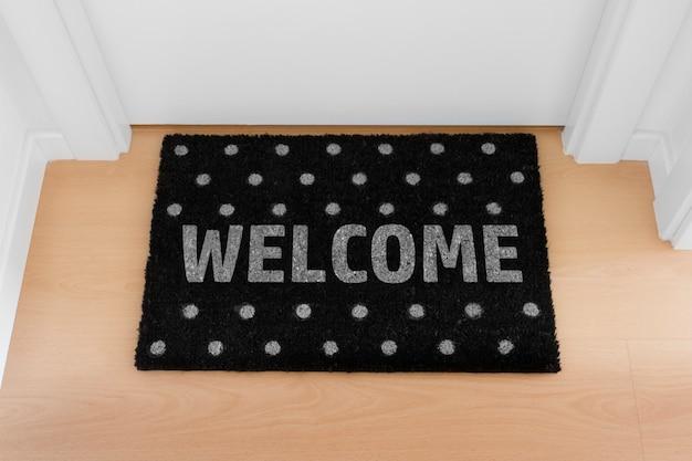 Bienvenido a casa alfombra negra. casa