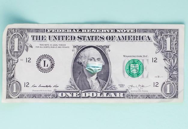 Billete de un dólar con máscara médica