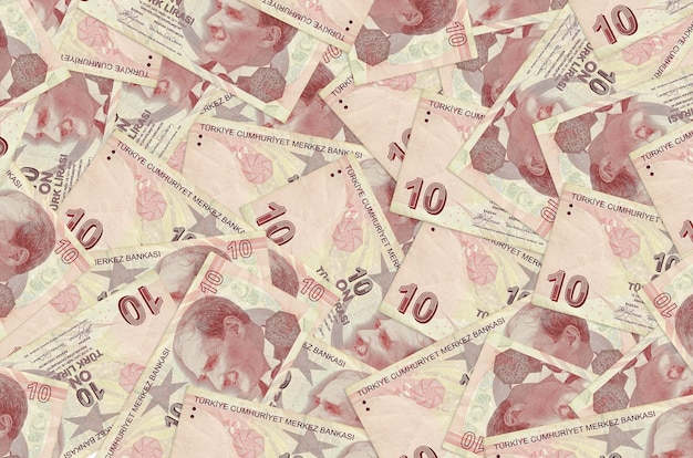 Billetes de 10 liras turcas se encuentran en una gran pila. pared conceptual de la rica vida. gran cantidad de dinero