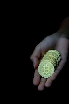 Bitcoin en mano