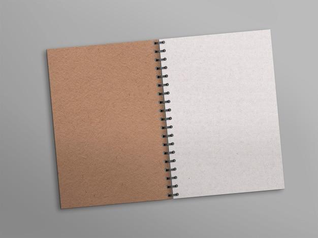 Bloc de notas abierto con papel blanco