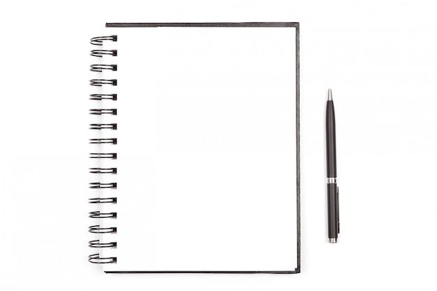 Bloc de notas y un bolígrafo