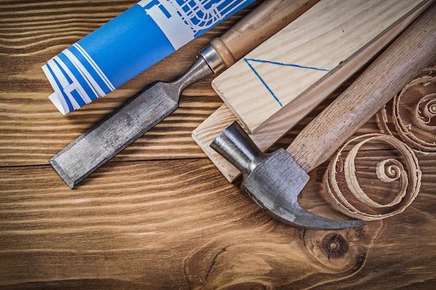 Blue blueprint martillo de garra cincel plano virutas de madera tachuelas en