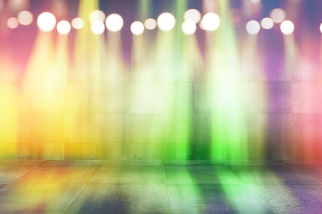 Bokeh abstracto luz de neón del arco iris en el fondo oscuro escena vacía