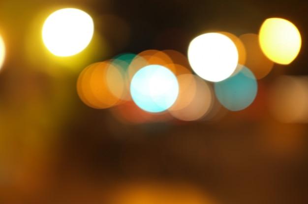 Bokeh dorado luz abstracta, fondo naranja