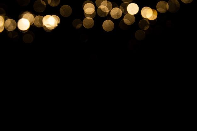 Bokeh de oro abstracto con fondo negro