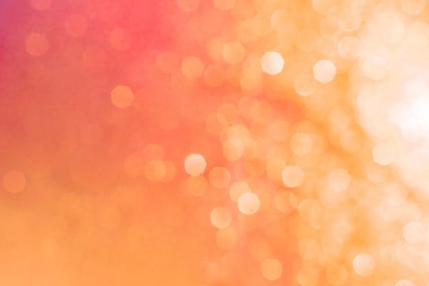 Bokeh textura abstracta. hermoso fondo de navidad en colores naranja. desenfocado