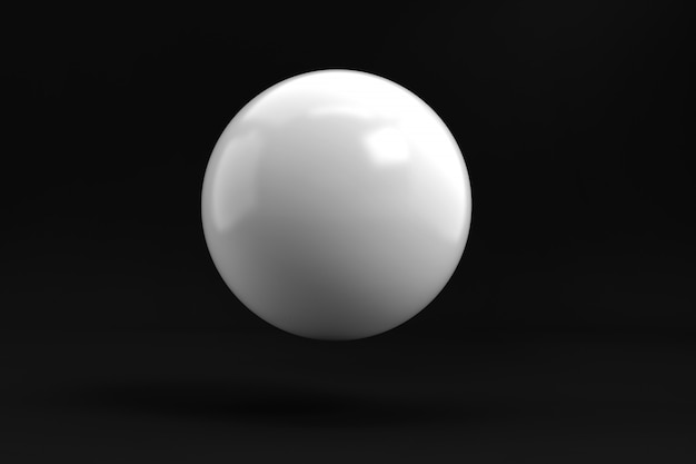 Bola blanca simple de la esfera en fondo negro del estudio