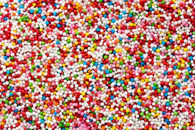 Bolas de azúcar dulce multicolor. fondo de textura de bola pequeña.
