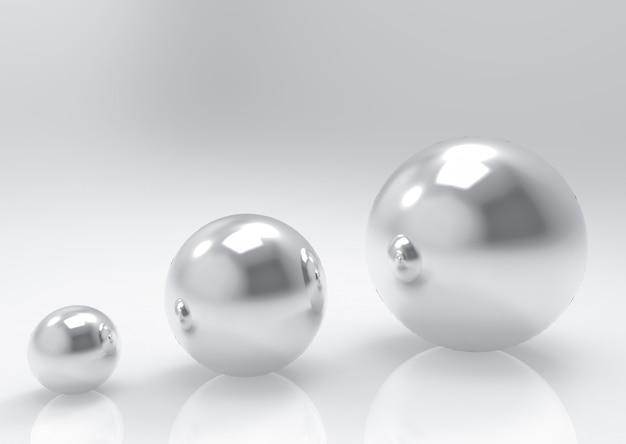 Bolas de esfera de acero ordenadas de pequeñas a grandes de metal sobre fondo gris.