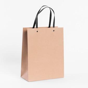 Bolsa de papel para compras con asas de tela negra