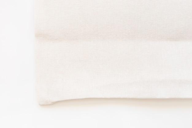 Bolso de compras del paño de la tela de la lona de la bolsa de asas en el fondo blanco