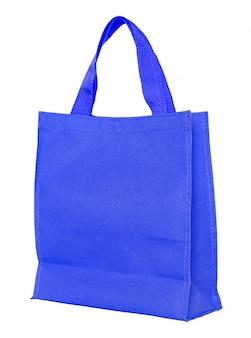 Bolso de compras azul de la lona aislado en el fondo blanco con el camino de recortes