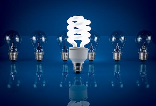 Bombilla de ahorro de energía incandescente entre bombillas incandescentes sobre fondo azul. concepto de ahorro de energía