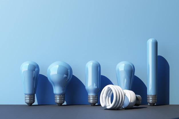 Bombilla fluorescente de luz blanca led sobre fondo de pared azul rodeada de lámpara incandescente - representación 3d