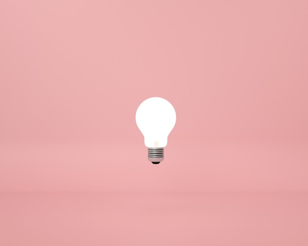 Bombilla en rosa. concepto de idea creativa mínima.