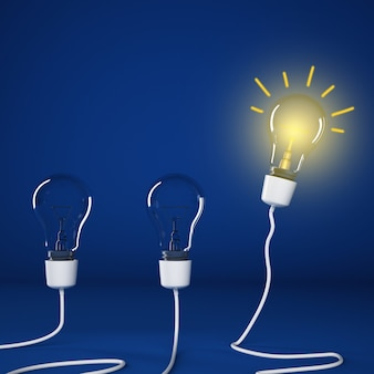 Bombillas brillantes encendidas entre bombillas apagadas. idea exitosa e inteligente
