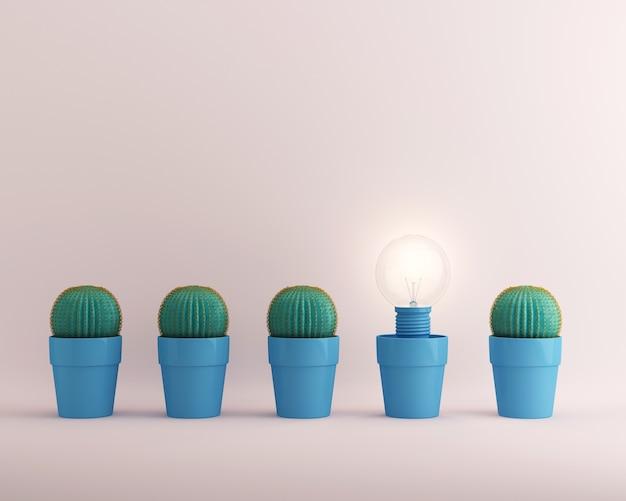Bombillas que brillan intensamente una idea diferente cactus en crisol azul de la flor en el fondo blanco