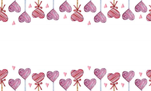 Borde de acuarela hecho de piruletas en forma de corazón