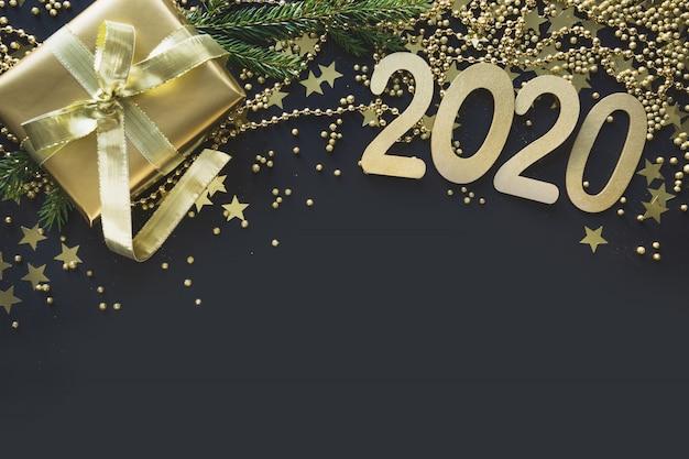 Borde navideño de caja de regalo dorada