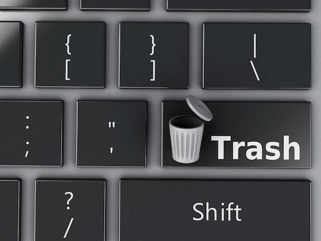 Bote de basura 3d en el teclado de la computadora.