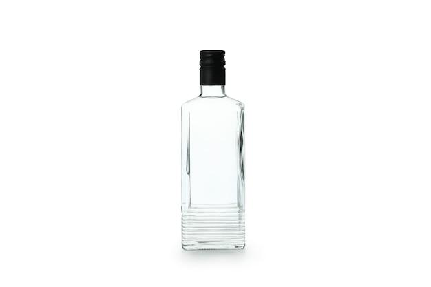Botella de bebida en blanco aislado en la pared blanca