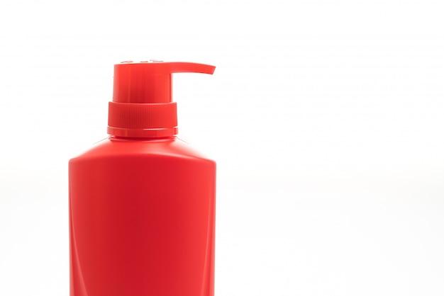 Botella de champú para el cabello sobre fondo blanco.