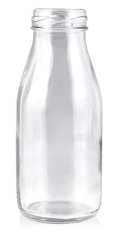 Botella de cristal vacía aislada en la pared blanca.