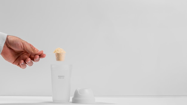 Botella de espacio de copia con suplementos de gimnasio