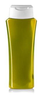 Botella de gel de ducha dorada aislada en blanco