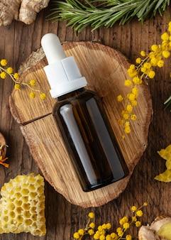Botella de suero y planta vista superior
