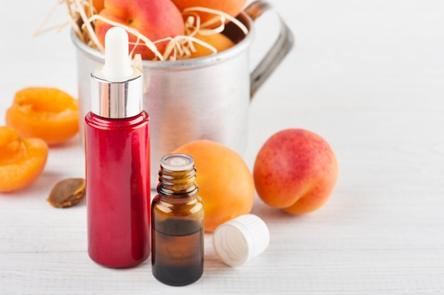 Botellas de aceite esencial de granos de albaricoque